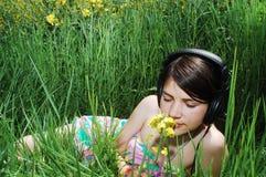 Girl in summer meadow Stock Image