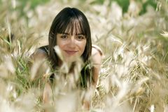 Girl in summer meadow Royalty Free Stock Photo