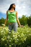 The girl on a summer meadow Stock Photography