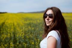 Girl on a summer meadow Royalty Free Stock Photos
