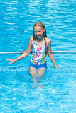 Girl in summer outdoor pool. Royalty Free Stock Photography
