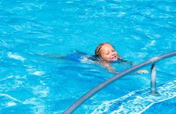 Girl in summer outdoor pool. Stock Images