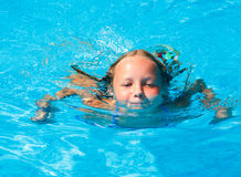 Girl in summer outdoor pool. Royalty Free Stock Photos