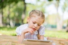 Girl in summer park Stock Image