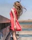 Girl on a summery beach Stock Photos