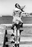 Girl on a summery beach Stock Photo