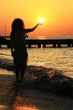 Girl and sun Stock Photography
