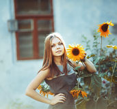 Girl with sun flower Stock Images