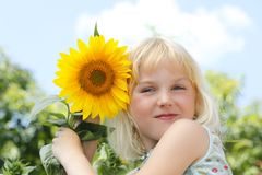 Girl with sun flowers Royalty Free Stock Photos