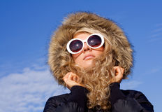 Girl in sun glasses. Beautiful girl in big sun glasses against blue sky Stock Images