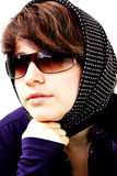 The girl in sun glasses and a scarf in peas 3 Stock Images