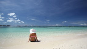 Girl in sun hat relaxing on tropical beach stock video footage