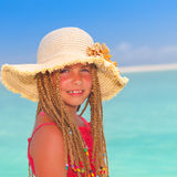 Girl with sun hat at tropical destination Royalty Free Stock Images