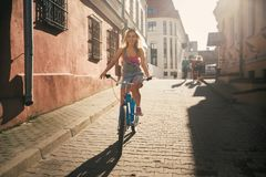Girl in the sun on a retro bike royalty free stock image