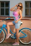 Girl in the sun on a retro bike royalty free stock photography