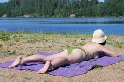 Girl sunbathes Stock Photography