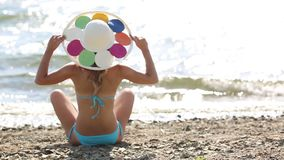The girl sunbathes on the beach in a yoga pose. stock video