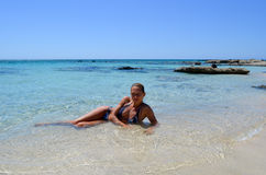 Girl sunbathes Stock Photo