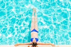 Girl sunbathes lying Stock Photo