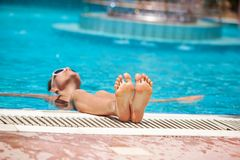 Girl is relaxing at the pool Stock Photos