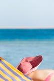 The girl sunbathes on  seashore Stock Photo