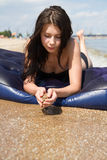 Girl sunbathing on air mattress in sea Royalty Free Stock Images