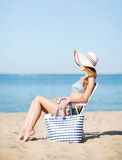 Girl sunbathing on the beach chair Royalty Free Stock Photos