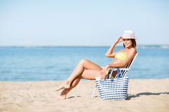 Girl sunbathing on the beach chair Royalty Free Stock Photography