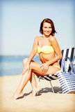 Girl sunbathing on the beach chair Royalty Free Stock Image
