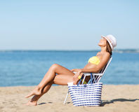 Girl sunbathing on the beach chair Stock Photo