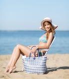 Girl sunbathing on the beach chair Royalty Free Stock Photography