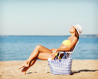 Girl sunbathing on the beach chair Royalty Free Stock Photo