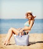 Girl sunbathing on the beach chair Royalty Free Stock Photo