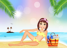 Girl sunbathing on the beach Royalty Free Stock Image