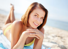 Girl sunbathing on the beach Royalty Free Stock Images