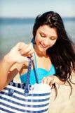 Girl sunbathing on the beach Royalty Free Stock Photos