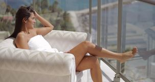 Girl sunbathing on hotel balcony stock footage