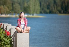 Girl sunbathing by the lake Stock Images
