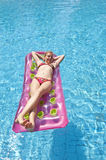 Girl sunbathing on a mattress Royalty Free Stock Photo