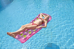 Girl sunbathing on a mattress Stock Photography