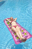 Girl sunbathing on a mattress Stock Images