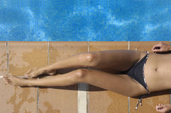 A girl sunbathing. By the pool Stock Image
