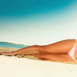 Girl sunbathing tanning on the beach. Royalty Free Stock Photography