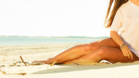 Girl sunbathing tanning on the beach. Stock Photos