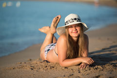 Girl sunbathing wearing hat Stock Image