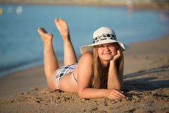 Girl sunbathing wearing hat Stock Images