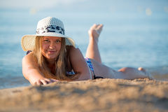 Girl sunbathing wearing hat Royalty Free Stock Photos