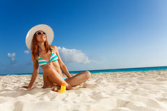 Girl sunbathing on white sand beach Stock Images