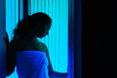 Girl beside sunbed 3 Stock Photos