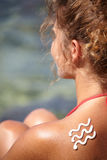 Girl  with sunburn and wave of sun lotion Stock Photo